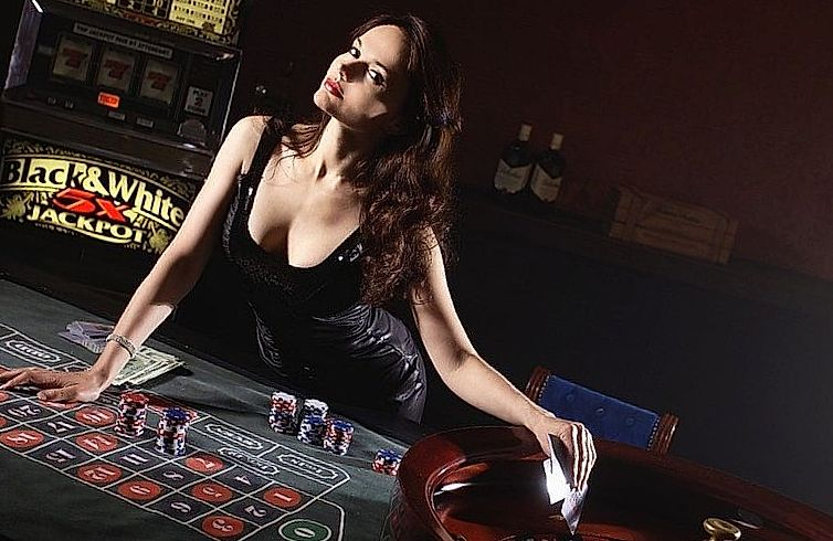 Young brunette playing poker